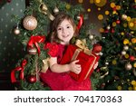 little girl with christmas...   Shutterstock . vector #704170363