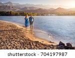 beautiful couple walking on the ... | Shutterstock . vector #704197987