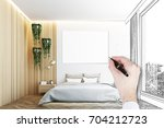 man s hand drawing a gray and... | Shutterstock . vector #704212723