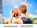 male playing basketball outdoor | Shutterstock . vector #704220097