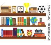 book shelf.  bookstore indoor.... | Shutterstock .eps vector #704225437
