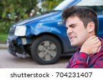 Small photo of Male Motorist Suffering From Whiplash After Car Accident