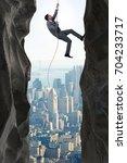 businessman overcoming...   Shutterstock . vector #704233717