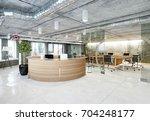 modern  loft office reception.... | Shutterstock . vector #704248177
