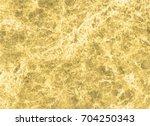 gold marble texture | Shutterstock . vector #704250343