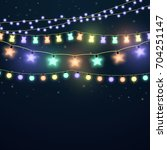 set of colorful glowing light... | Shutterstock .eps vector #704251147