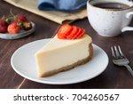 slice of plain new york... | Shutterstock . vector #704260567