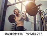 muscular man workout with... | Shutterstock . vector #704288077