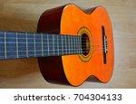 classical guitar | Shutterstock . vector #704304133