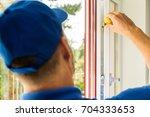 plastic pvc window maintenance...   Shutterstock . vector #704333653