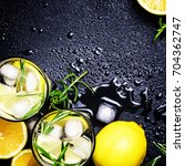 cold lemon drink with rosemary  ... | Shutterstock . vector #704362747
