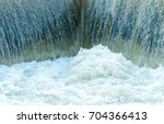 Small Dam With Water Flowing...