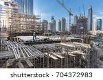 laborers working on modern... | Shutterstock . vector #704372983