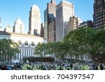 crowds of people gather on the... | Shutterstock . vector #704397547