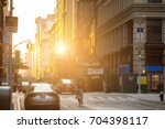 delivery man rides bike down... | Shutterstock . vector #704398117