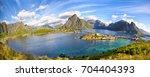 reine fishing village and... | Shutterstock . vector #704404393