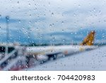 raindrops on airplane window at ...   Shutterstock . vector #704420983