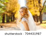 portrait of a bride looking at... | Shutterstock . vector #704431987