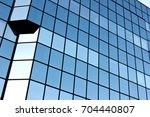 blue windows of a modern office ...   Shutterstock . vector #704440807