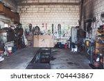 a garage for trucks repairing... | Shutterstock . vector #704443867