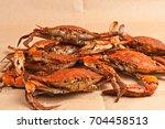 pile of steamed  seasoned  male ... | Shutterstock . vector #704458513