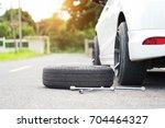 auto mechanic changing wheel ...   Shutterstock . vector #704464327
