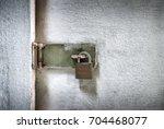 Small photo of An Old Locked Padlock to Deny Access