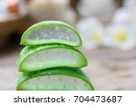 alo vera sliced spa treatment... | Shutterstock . vector #704473687