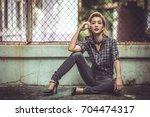 beautiful woman in rock n 'roll ... | Shutterstock . vector #704474317