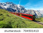 a cog wheel train travels on... | Shutterstock . vector #704501413
