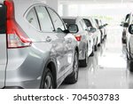 a row of new cars parked at a... | Shutterstock . vector #704503783