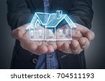 architect with a virtual model... | Shutterstock . vector #704511193