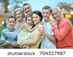 big happy family standing... | Shutterstock . vector #704527987