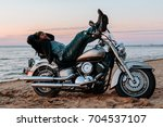 Man Sleeping On A Motorcycle O...
