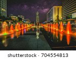 Small photo of Colorful fountain at Gwanghwamun Plaza with statue of Admiral Yin-Sin, Sin and Milky Way in Seoul City.Photo in Seoul, South Korea
