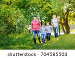 happy family rest on the nature ... | Shutterstock . vector #704585503