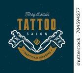 tattoo studio emblem. hand... | Shutterstock .eps vector #704594377