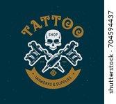 tattoo studio emblem. human...   Shutterstock .eps vector #704594437