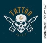 tattoo studio emblem. human...   Shutterstock .eps vector #704594467