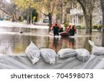 flood protection sandbags with... | Shutterstock . vector #704598073