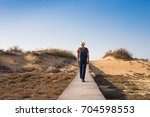 hiker walks alone. travel and... | Shutterstock . vector #704598553