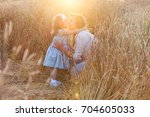 happy mother holding and...   Shutterstock . vector #704605033