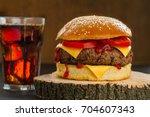 hamburger on wood slice and soda | Shutterstock . vector #704607343