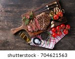 grilled steak served with...   Shutterstock . vector #704621563