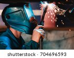 man in a mask does welding... | Shutterstock . vector #704696593