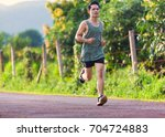 healthy young man running on... | Shutterstock . vector #704724883