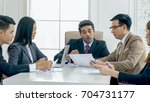 the chief of business team is...   Shutterstock . vector #704731177