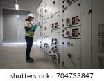 young engineer working on the... | Shutterstock . vector #704733847