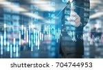 businessman hand touch virtual... | Shutterstock . vector #704744953