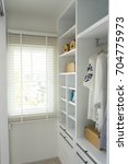 walk  in closet with cloth and... | Shutterstock . vector #704775973